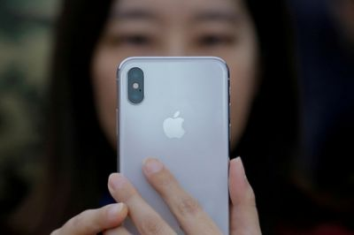 Apple halves iPhone X production